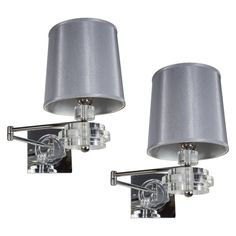 Pair of Mid-Century Swing-Arm Sconces in Chrome and Stacked Lucite Detail | From a unique collection of antique and modern wall lights and sconces at https://www.1stdibs.com/furniture/lighting/sconces-wall-lights/