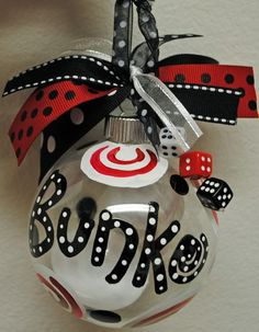 Bunco Ornament - hot pink and black and hang from the kitchen window as decoration.