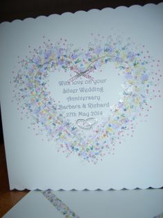 Silver Wedding card made using Card-i-O tapestry peg stamps