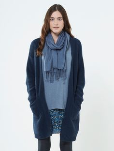 Woolly and wonderful, plain edge to edge cardigan in slate blue and grey, a much coveted cardi this season. Deep front pockets and thick edging detail. Chunky knitted warm wool and soft cotton mix with just a touch of viscose to hold the shape. Perfect to pop on over almost any of our styles, when snuggled up at home or popping out and about.