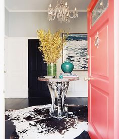 Bright coral door + graphic cowhide rug = a combo we adore.