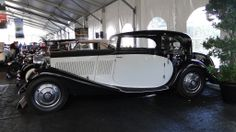 A black and white Rolls Royce - classic and would work great with Chanel. :)