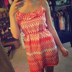 Chevron print dress Orange and white chevron dress with thin belt included. There is a tiny tear in one strap that can easily be fixed. It's minor- I might fix it myself if I decide to keep. Otherwise in prefect condition. Francesca's Collections Dresses Mini