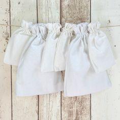 Baumwollbeutel weiß - Set von sechs Baumwollbeuteln mit Zugband.