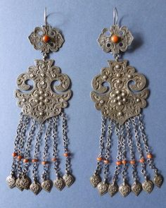 Uighur silver and coral earrings from Howah Chen. The Uyghurs  are a Turkic ethnic group living in Eastern and Central Asia.