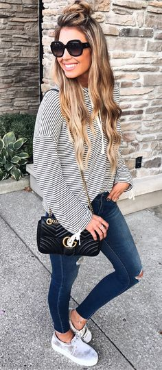 #fall #outfits women's white and gray stripe  hoodie and blue jeans