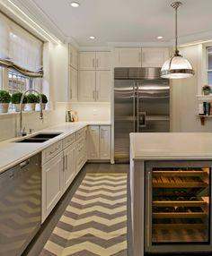 ivory & white kitchen + off-white quartz + gray hardwood floors