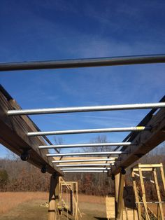 Looking down the length of the Monkey Bars with the new metal rungs.