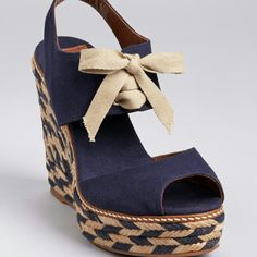 Navy wedges  Tory Bury  org $135 Navy wedges, super adorable.  Great for spring and summer.  New in box, never used. 100% authentic.  Add them to your vacation wardrobe. Approx 4 3/4 inch heel w 1inch platform.  (Comparable to a 3 3/4 inch heel) cotton upper/ leather lining. Tory Burch Shoes