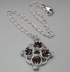 """Original design by me, Kat Wisniewski of Elemental Art Jewelry. This stunning Celtic chainmaille weave utilizes purple bronze pressed glass rings, aluminum rings and purple bronze glass beads to form a radiant pendant that lures viewers to it.  This piece can be custom made with a variety of metals and colors of glass. 20"""" in length-Can be shortened at no additional cost. Want to make this yourself? Check out my tutorial listing for this item!"""