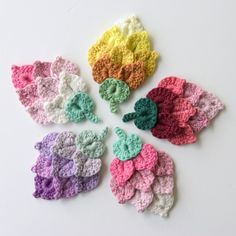 Crochet tulips. Have a look at THeCurioCraftsRoom on Etsy! Lovely crochet flowers and more.