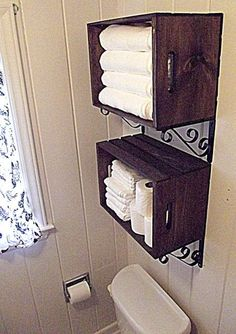 Crate Wall Storage–Inexpensive crates, stained, and hung with brackets.  Great idea for a small room with limited storage, like a hall half bath.