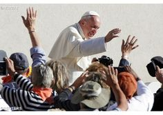 Pope Francis waves to pilgrims as he arrives in St. Peter's Square for the General Audience  - REUTERS