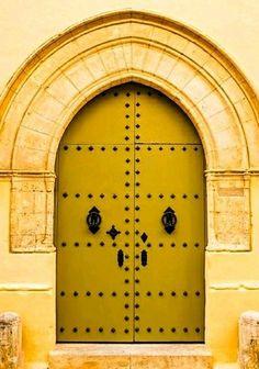 Golden Mediterranean door on the Island of Malta. - by Kelly Wearstler