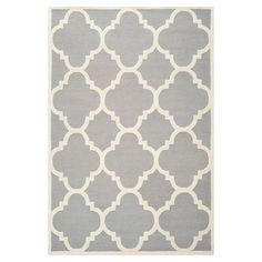 Silver and ivory wool rug with a quatrefoil trellis motif. Hand-tufted in India.  Product: RugConstruction Material:...