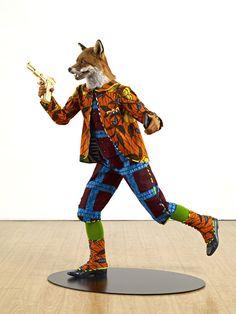 Yinka Shonibare, MBE (RA) | Artwork - Mannequin, Dutch wax printed cotton, fiberglass, leather, taxidermy fox head, blackberry and 24 carat gold gilded gun. 2012. yinkashonibarembe.com