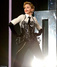 Queen of reinvention: Madonna performs Vogue on stage during her MDNA tour debut at Ramat Gan Stadium in Israel, wearing a recreation of the iconic Jean Paul Gaultier bustier