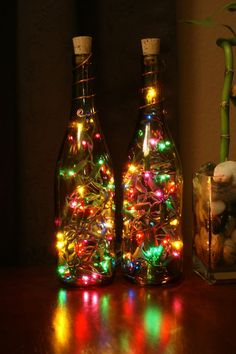#Recycle your old wine botltles and stuff them with #ChristmasLights to make a great #ChristmasDecoration