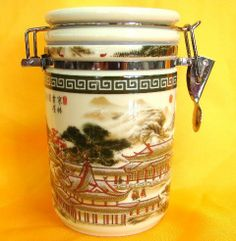 """Tea Can/Container by Chinese Collectibles. $34.66. Porcelain Hand Decorated Chinese Tea Can with Mountain and House PictureIt is made of high quality porcelain and approx. 6"""" in height"""