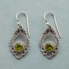 "PERIDOT PAISLEY EARRINGS -- Peridot shines ever green in sterling silver danglers that recall the intricate paisley in fine antique shawls. Sterling silver wires. Exclusive. 1-1/4""L."