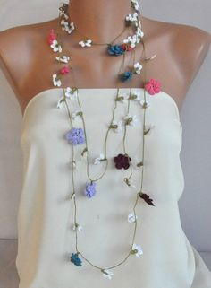 Couldn't open the link , but seems simple enough. Necklace with very thin thread and attach the flowers as you go