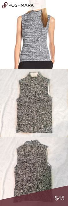 Theory knit turtle neck tank Theory white and black ribbed turtle neck tank! In amazing condition! The material is pretty stretchy. 87% viscose, 10% polyester, 3% spandex. Theory Tops