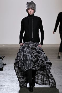Zero + Maria Cornejo 2013: With out the hat and a lower neckline, imagine how COOL this would look for day. Embrace the drama!