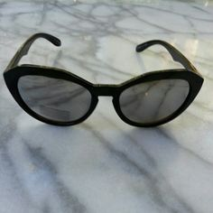 Geo Cut Cat Eye Sunglasses Black rounded cat eye frames with mirrored lenses. 100% UVA/UVB protection. Urban Outfitters Accessories Sunglasses