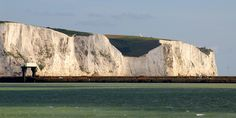 Panorama of the White Cliffs of Dover in Sunlight and Shadow, Kent, England, UK. Iconic chalk (calcium carbonate) and flint. Eastern Arm pier, South Foreland lighthouse. National Trust nature reserve, Langdon Cliffs. Julius Caesar, Romans in 55 BC. Vera Lynn's World War II song There'll be Bluebirds over the White Cliffs of Dover. North Downs grassland. Geography, Geology, Photography, Travel, Tourism, and History. More information at http://www.panoramio.com/photo/47735181