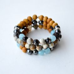 The Holistic Rain Earth Rainbow Hamsa Bundle.  Handmade Gemstone and Sandalwood yoga bracelets / wrist malas with sterling Hamsa charm.