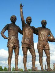 The United Trinity. George Best, Dennis Law and Bobby Charlton outside Old Trafford home of Manchester United FC.