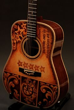Handmade Acoustic Guitar by custom guitar builder Jay Lichty, artwork by Clark Hipolito