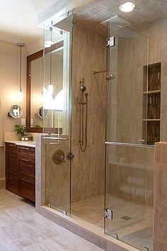 Frameless shower doors slide apart to reveal a sumptuous bathing area.