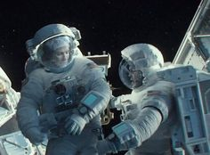 Sandra Bullock and George Clooney in Gravity Movie