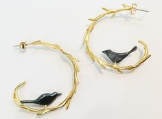 Yellow gold bird on branches hoop earrings.