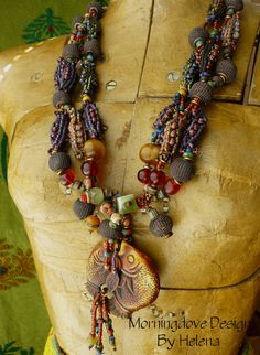 Necklace | Helena Nelson-Reed.  Seed beads, Tibetan mala beads, jasper, Peking glass, vintage and new brass, hollow woven 'basket' beads, hollow metal beads and double fish pendant.