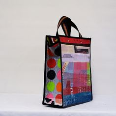 recycled plastic grocery bag by Nina Fused Plastic, Recycled Plastic Bags, Plastic Grocery Bags, Plastic Bottles, Newspaper Bags, Candy Wrappers, Pet Bottle, Recycled Fashion, Household Items