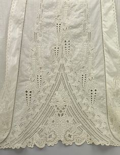 Christening robe and bodice  Linen robe and dress for a baby embroidered with white cutwork made in England in the nineteenth century