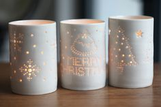 Handmade Christmas themed maxi tealights in ivory white porcelain - snowflakes, merry christmas and christmas trees all @ £36 inc p&p each from Luna Lighting on 07774 626536