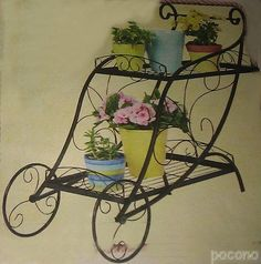 wrought iron garden cart with flower planters