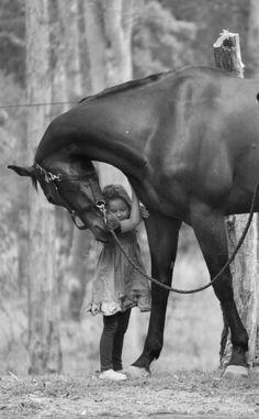 Niña con su caballo