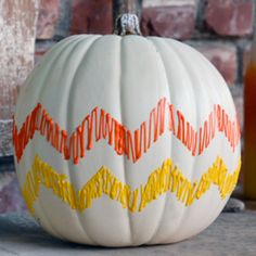Grab some Puffy Paint and painter's tape and go to town with this candy corn-inspired pumpkin!