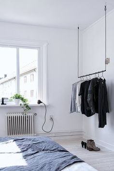 / i like the hanging rack of clothes, looks orderly and modern /