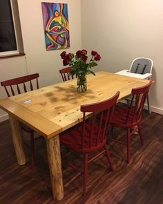 Farmhouse table with breadboard ends. Blue-stained (beetle-killed) lodgepole pine legs. Custom-made Wyoming rustic table.