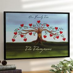 """This is so beautiful! It's a canvas print of your family tree that you can have personalized at PersonalizationMall! Each heart can hold a family member's name and you can have """"Est.____"""" with any year you want on the tree trunk - so cute! You get to pick what you'd like it to say at the top and bottom and it comes in different sizes, too! They start as low as $38.95 - GREAT gift idea! #Family"""