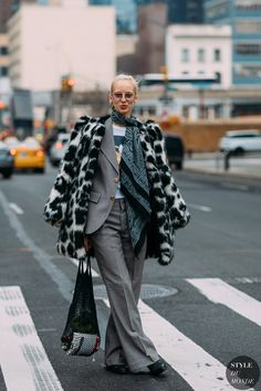 How to sum-up the NYFW Fall 2018 street style scene? Coat porn and more coat porn. You need to see this.