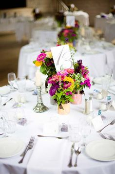 The flowers celebrated the beauty of Northern Michigan, with local wildflowers and aromatic herbs in the centerpieces and bouquets.