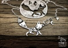 ᎢhᎧ ᏣurᎥᏍᎦ FᎾx by Hairy Growler, Hand cut out  and upcycled silver curious fox necklace made from silver coins