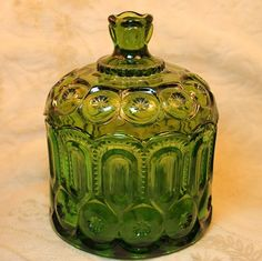 Vintage Moon and Stars Green Glass Candy Dish is a beauty and is in excellent condition! It's pressed pattern features inverted teardrops, circles with hobstars, and some sawtooth accents. The edge of