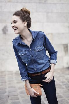 denim shirt. black jeans.  Clio Goldbrenner